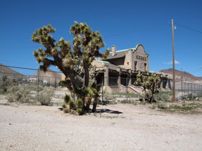 A Joshua tree next to a remains of the old train station