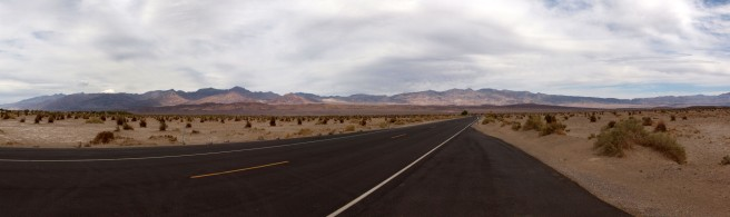 Driving into Death Valley under partly cloudy skies
