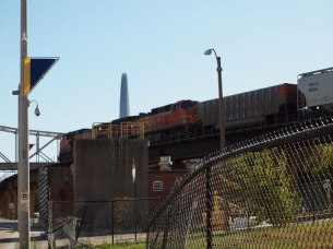 A Freight train approaches the Gateway Arch